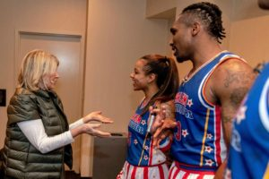 Afterwards, we had the opportunity to meet some of the players. Here I am talking to Ice Hrynko and Thunder Law. Ice is one of two top female players who joined the roster this year. (Photo courtesy of Harlem Globetrotters)