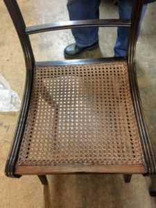 Once all the caning is done, the next day, the chair is stained in the same color as the old seat.