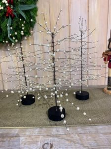 These are Pearl Bead Trees - three sizes of pearl beads arranged throughout twisted wire branches on black lacquered bases. They can be used alone or with the bottlebrush trees on your dining table.