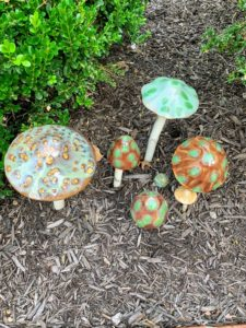 Outside the shop are some of the whimsical ceramic mushrooms that is available at the store.