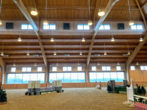 Attached to the barn is a cathedral inspired 170-foot by 95-foot indoor arena.