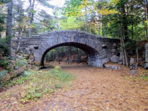 And this is Bubble Pond Bridge. Bubble Pond Bridge was constructed in 1928 and is the only solid masonry bridge in Acadia National park. This medium-sized bridge is located on the north side of Bubble Pond. The stone and mortar substructures are surfaced in rough-dressed random laid rubble stone.