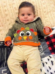 We are so thankful for several babies that were born this year. This is Ethan Cole, the son of executive assistant, Cathryn DelaRosa. Ethan is five-months old and growing very fast. Here is Ethan in his first Thanksgiving dinner outfit.
