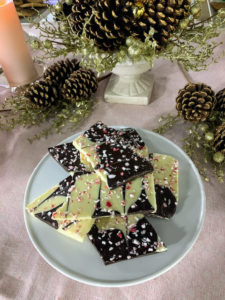 The Peppermint Bark is made from premium white and dark chocolate, and peppermint candies. The chocolate is hand feathered, and then hand sprinkled with peppermint candy.