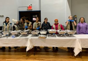 Anduin also shared this photo of her daughter Harper's girl scout troop - all the girls served Thanksgiving dinner at their local church. Harper is on the left wearing the hat and talking with her mom.