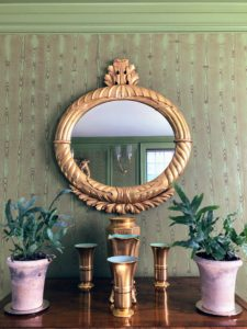 On this antique desk, more tropical houseplants sit around my gold German vases.