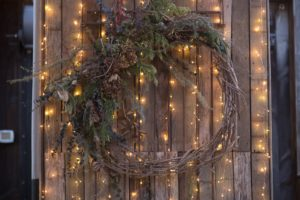 A pretty, all-natural wreath was also lit up nearby. (Photo by Katie Hennessey)