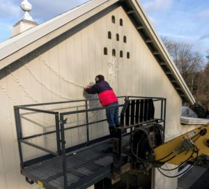After checking that all the lights work on the star, Fernando is carefully lifted on the Hi-Lo to position this star above the doors of my Equipment Barn.