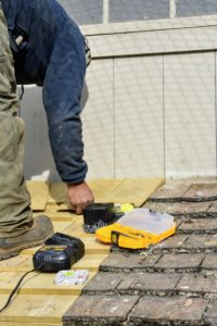 Pete replaces any old shingles that are broken or timeworn.