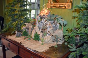 Flanking the creche are two slender and tall Christmas trees left completely undecorated - they are so beautiful as is.