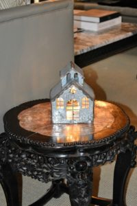 On a nearby side table - one house, lit from the inside. Decorations don't always have to be elaborate to be beautiful.