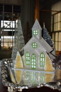 Here is a charming village chapel on this tray located at the opposite side of the room.
