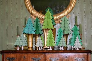 More Christmas trees bedeck this highboy in the Green Parlor. Here, we grouped many together to create this enchanting holiday forest.