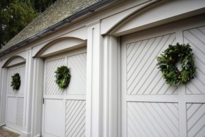 This gym garage is currently being used for storage, so the sliding doors are not opened too often. When hanging outdoor wreaths on windows and doors, make sure those openings can still be opened and closed properly if needed.