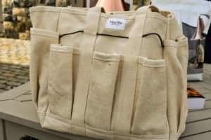To store all the tools, we offer the Martha Stewart Heavy-Duty Canvas Garden Bag, with 6 Exterior 11-Inch Interior Pockets. Expertly stitched with premium-quality, heavyweight cotton canvas, this spacious bag can safely stash a variety of gardening essentials. It also has reinforced carrying handles and a sturdy shoulder strap - just the right size to tote around the yard, garage, or garden.
