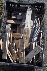 All the wooden stakes, strips and shims are milled at the farm and get reused from year to year. Even scraps of wood can be repurposed for various projects. The strips are about six to eight inches long – just long enough to accommodate two screws that will keep the burlap secure for the season.