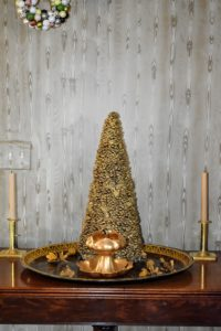 I love these gold trees. Even one placed on a table looks merry.