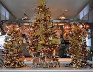 On my kitchen counter - this trio of copper tinsel trees with deer around the base. They look perfect with my copper pots above. All my guests adore these trees.