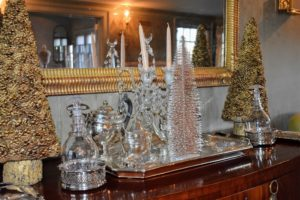 In my small dining room, a silver tray is decorated with more glittered pinecone and bottle brush trees.