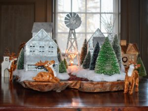 The mantle is decorated with another holiday village scene.