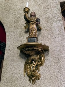 This is one of a pair of early 17th century Giltwood carved winged angel wall candlesticks.