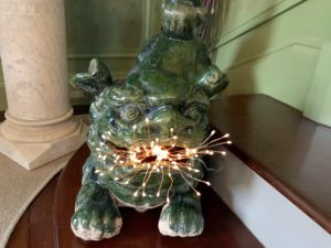 This is one of two foo dogs given to me by Kevin Sharkey. They're perfect for my Green Parlor. We placed Christmas lights in its mouth to look like fire.