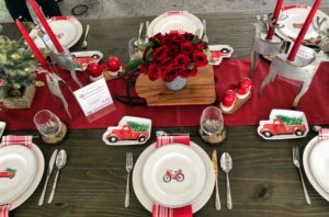 "In the center of the Pavilion is a table dressed with pieces from my ""Winterberry"" collection exclusively at Macy's. This collection includes whimsical holiday designs that combine traditional red and green hues with metallic textures for the table. goo.gl/khNeDm"