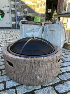 And here is my faux bois 35-Inch Diameter Cast Stone Base, Wood Burning Fire Pit. It features a wire mesh screen to protect against sparks and provides an open view of the fire. This pit accommodates hardwood logs up to 21-inches long.