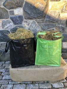 Here they are in black and bay leaf green - they are so versatile. These bags are made from rugged, rip-resistant woven polypropylene fabric and designed to provide years use in the yard, garden, and around the house. Plus, they're easy to clean - just wipe them with a damp cloth.