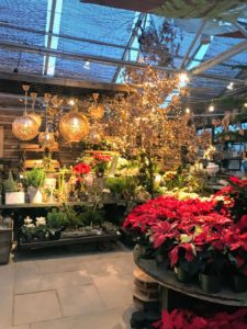 Inside, guests were greeted by lots of poinsettias, holiday lights and tables filled with decorations.