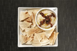 Hummus is a healthier alternative to cream- and dairy-based dips – and, it makes a beautiful presentation with freshly cut pita bread or crispy pita chips.