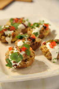 "Another great ""small bites"" idea - stuff potato skins with ground beef, tomatoes, sour cream, jalapeno peppers, and other taco-inspired toppings. It's a delicious way to combine two favorites in one."