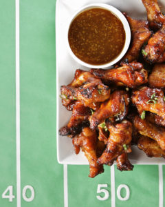 There's more than one way to prepare chicken wings! Here's a great recipe for baked wings with a spicy-sweet glaze of sriracha and honey.