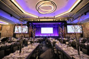 Guests gathered inside the Hilton's Grand Ballroom, which is more than 27-thousand square feet. The center tables were designated for students, while industry guests and leaders sat at round tables surrounding them.