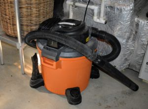A wet-dry vacuum is also stored nearby.