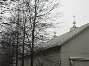 From up close, the three finials above my Equipment Barn are still visible, though the sky appears very gray and ominous.