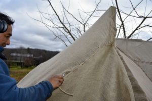 This is one end of the hedge - all the burlap is pulled taut and sewn neatly.