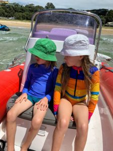 Next, we took a ride on a lovely picnic boat with one of the Fox Family sons. The children are wearing long sleeves with high collars and hats to protect them from the strong UV rays.