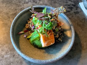 This is a hot smoked Huon salmon served with local avocado and a salad.