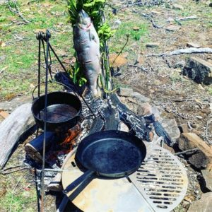 Tripods were set up for a grill and cast iron pots. And as the salmon cooked, the skillets and pots were heated over the fire.