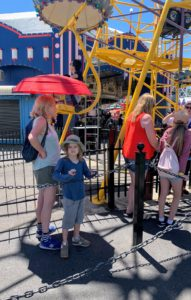 Here's Truman and our friend, Pamela, waiting in line for one of the rides - it was very crowded and very warm. Be sure to go to my Instagram page @MarthaStewart48 to see photos of the children on the carousel.