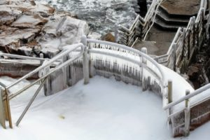 These icicles on the stairwell railing at Thunder Hole are about a foot long, and some longer.