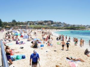 Australians love going to the beach on Christmas Day - there were so many people enjoying the weather and sunshine. And because the ozone layer over Australia is thinned, which means more UV radiation reaches earth, it was important to be well protected.
