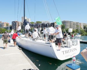 "Here is one of the boats making final preparations before the race. We were able to get pretty close to see the crews get ready. The ""Triton"" has competed in several of these races."