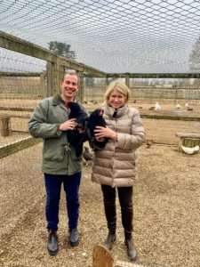 Here I am with Chris back at my farm with two of my three new Langshans. We are both very passionate about our chickens and their care.