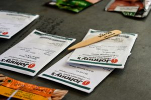 Ryan labels the seed markers and keeps them together with the matching packets.