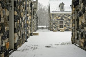 Here's a view of the stable courtyard, with all but a few of the cobblestones covered in snow.