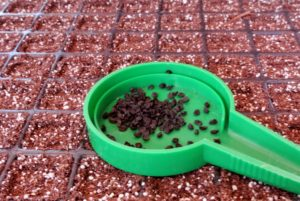 Just pour a generous amount of seeds into the center dish and then screw the plastic top back onto the hand seed sower and adjust the amount of seeds that will be released at one time.