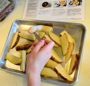 The next meal is the French Dip Burger & Oven Fries. Martha & Marley Spoon provides step-by-step instructions that are so easy to follow. While the oven is preheated to 450-degrees Fahrenheit, the potato is cut into 1/2-inch thick wedges and sprinkled with salt.