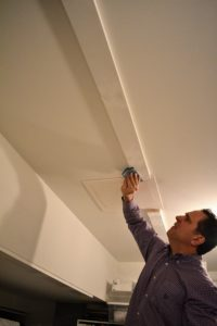 After the wood was installed, and the screws were covered with spackle, Fred sanded the area and primed it for painting.